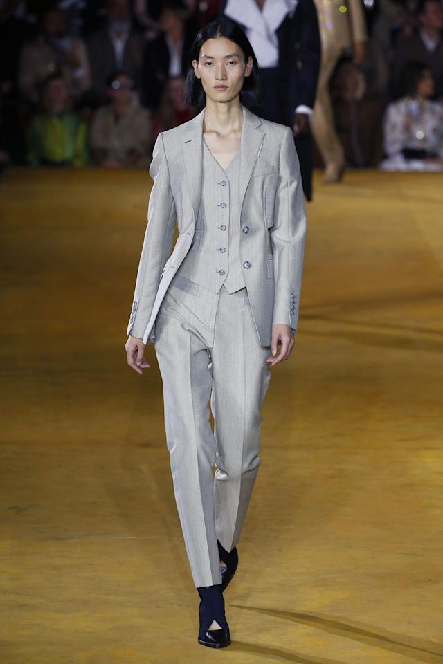 "<p>Riccardo Tisci continues to mine Burberry's archives to help inform his new era of Burberry. This season's collection theme was ""evolution,"" as Tisci works to evolve the original codes of the house of Burberry. For Spring 2020, Tisci presented his refined and relaxed side of Burberry again. Monochrome suiting in grey and beige,  and reconstructed trench coats led into gingham mini's, corsets and contrast print two-pieces. Evening wear veered on bridal (if you're a very cool bride) with a handstitched ostrich feathered frock, and a crystal mesh gown with feathered train. </p>"