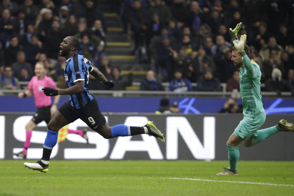 Inter Milan's Romelu Lukaku, left, reacts after a missed scoring opportunity during the Champions League, group F soccer match between Inter Milan and F.C. Barcelona, at the San Siro stadium in Milan, Italy, Tuesday, Dec. 10, 2019. (AP Photo/Luca Bruno)