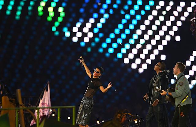 LONDON, ENGLAND - SEPTEMBER 09: Rihanna, Jay-Z and Chris Martin of Coldplay perform during the closing ceremony on day 11 of the London 2012 Paralympic Games at Olympic Stadium on September 9, 2012 in London, England. (Photo by Hannah Johnston/Getty Images)