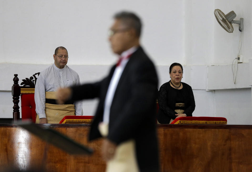 In this April 7, 2019, photo, Tonga King Tupou VI, left, and Queen Nanasipauʻu Tukuʻaho, right, attend a mass at the Free Wesleyan Church in Nuku'alofa, Tonga. China is pouring billions of dollars in aid and low-interest loans into the South Pacific, and even in the far-flung kingdom of Tonga there are signs that a battle for power and influence among much larger nations is heating up and could exact a toll. (AP Photo/Mark Baker)