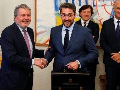 Spain's Culture Minister Maxim Huerta receives the ministerial briefcase from outgoing minister Inigo Mendez de Vigo at the Culture Ministry in Madrid, Spain June 7, 2018. REUTERS/Paul Hanna