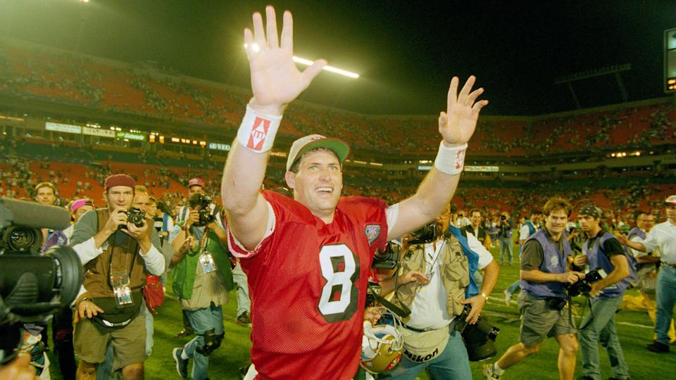 Mandatory Credit: Photo by Lenny Ignelzi/AP/Shutterstock (6528636a)Young San Francisco 49ers' Steve Young runs a victory lap after his team beat the San Diego Chargers in Super Bowl XXIX, at Miami's Joe Robbie Stadium.