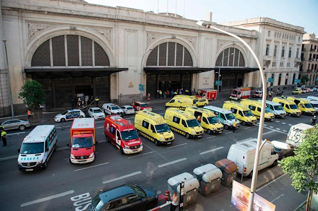 <p>Emergency vehicles are parked outfront of the Estacio de Franca (Franca station) in central Barcelona on July 28, 2017 after a regional train appears to have hit the end of the track inside the station injuring dozens of people. (Photo: Josep Lagos/AFP/Getty Images) </p>