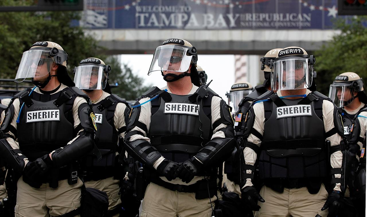 Law enforcement officers block a downtown street during a protest on August 27, 2012 in Tampa, Florida. The demonstration was being held just before of the start of the Republican's nominating convention which will hold its first session on August 28. The convention was scheduled to start on August 27 but was pushed back one day as Tropical Storm Isaac threatens to hit the Tampa area.  (Photo by Tom Pennington/Getty Images)