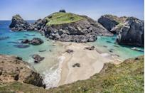 "<p>No, this isn't the Caribbean, and yes, this really is the UK. Head on a pilgrimage to the <a href=""https://www.cosmopolitan.com/uk/entertainment/travel/g31403021/best-beaches-in-cornwall/?slide=6"" rel=""nofollow noopener"" target=""_blank"" data-ylk=""slk:best beaches in Cornwall"" class=""link rapid-noclick-resp"">best beaches in Cornwall</a> to experience Kynance Cave, famous for its turquoise blue water, white sand shores and dark red and green serpentine rock, which protrude from the sea. Seriously gorgeous. <br></p><p><a class=""link rapid-noclick-resp"" href=""https://www.airbnb.co.uk/"" rel=""nofollow noopener"" target=""_blank"" data-ylk=""slk:FIND AN AIRBNB"">FIND AN AIRBNB</a></p>"