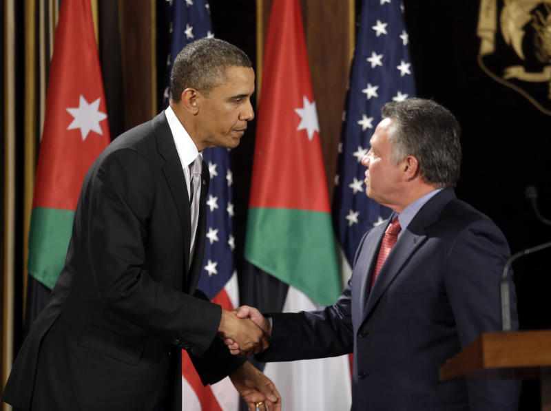 FILE - In this March 22, 2013, file photo, President Barack Obama, left, and Jordan's King Abdullah II, right, shake hands following their joint new conference at the King's Palace in Amman, Jordan. When Obama meets over the next month with leaders from Mideast and other regional nations, he will have a timely opportunity to try to rally the Syrian opposition's main backers around a unified strategy to oust Syrian President Bashar Assad. Jordan, Turkey, Qatar and the United Arab Emirates _ whose Sunni Muslim leaders will meet separately with Obama starting April 16_ are all believed to be arming or training rebel forces seeking to overthrow Assad's regime.  (AP Photo/Pablo Martinez Monsivais, File)