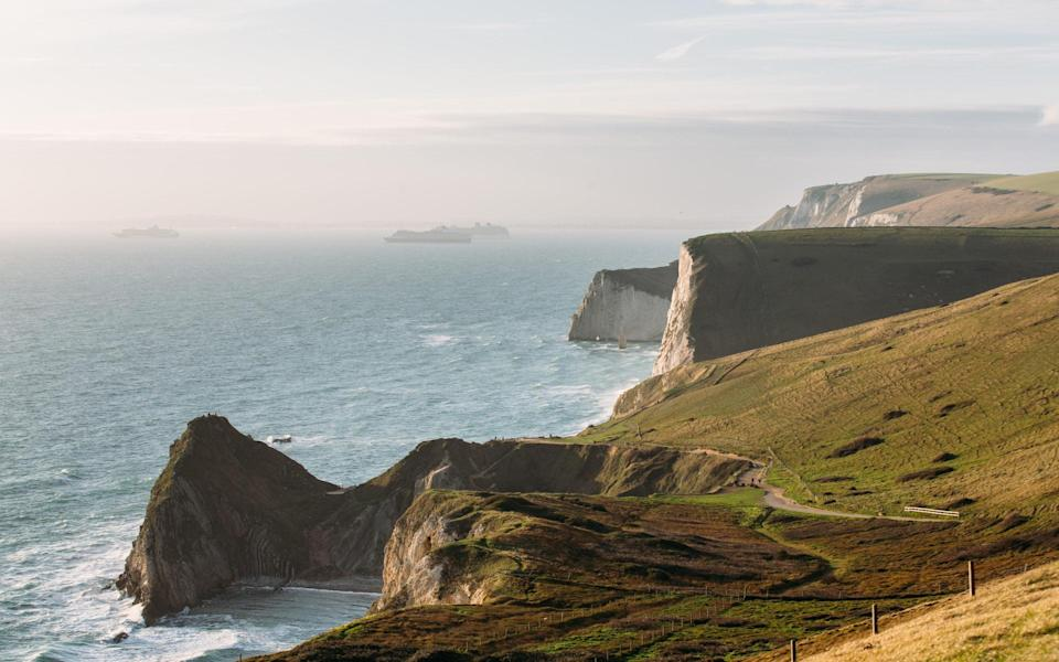 cruise ships in distance in dorset - Getty