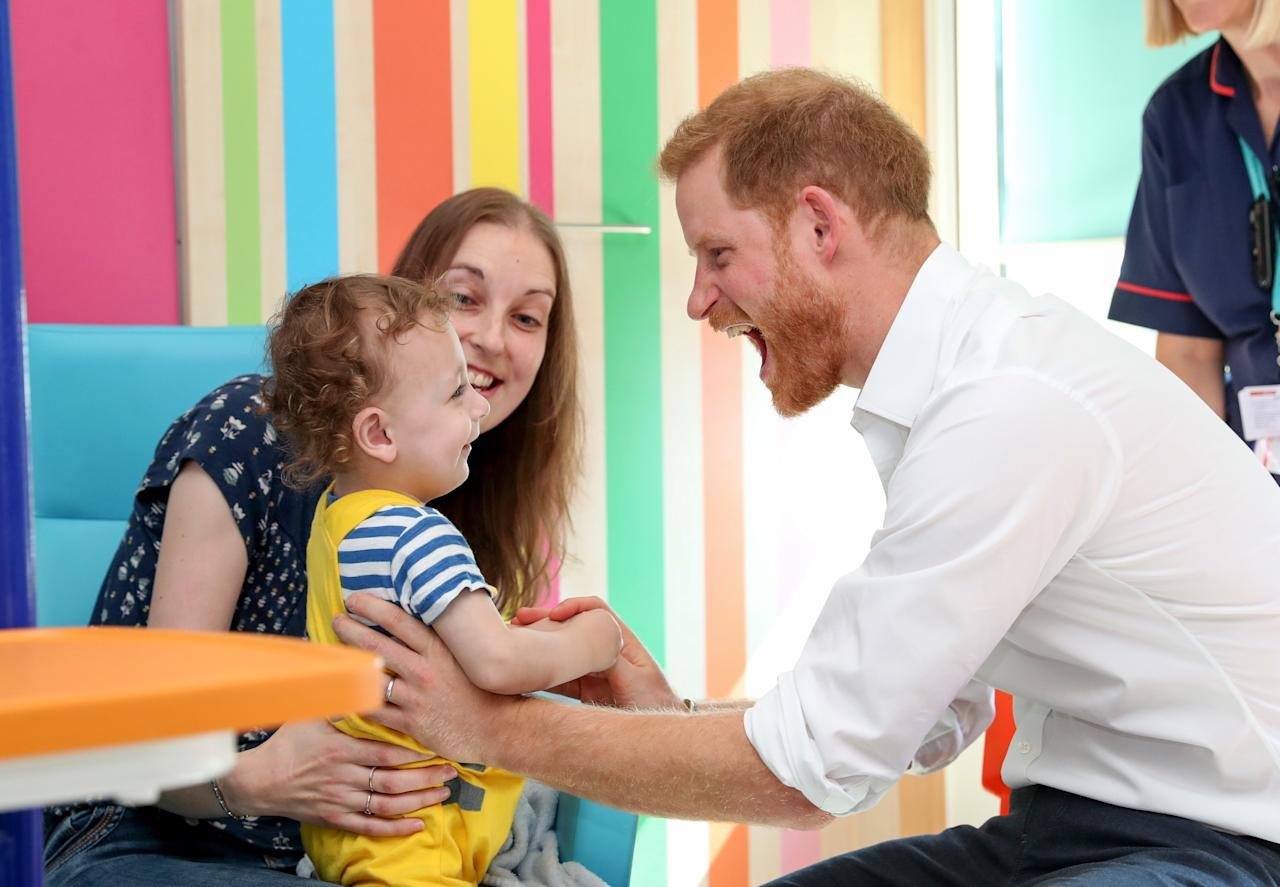 Prince Harry plays with 1-year-old Noah Nicholson during a Thursday visit to Sheffield Children's Hospital.