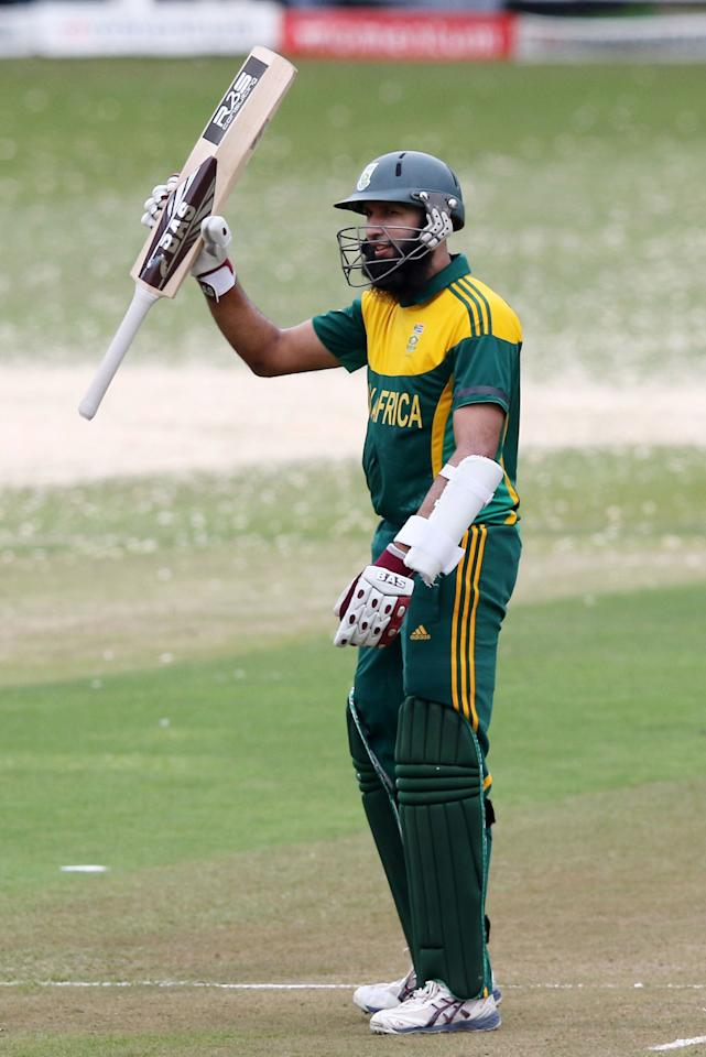 South Africa's Hashim Amla celebrates his 50 runs during the One day International (ODI) cricket match between South Africa and India at Sahara Stadium Kingsmead in Durban on December 8, 2013. AFP PHOTO / ANESH DEBIKY