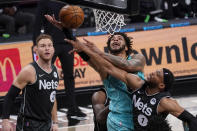 Brooklyn Nets forward Bruce Brown (1) stops Charlotte Hornets forward Miles Bridges from scoring during the second half of an NBA basketball game Friday, April 16, 2021, in New York. (AP Photo/Mary Altaffer)