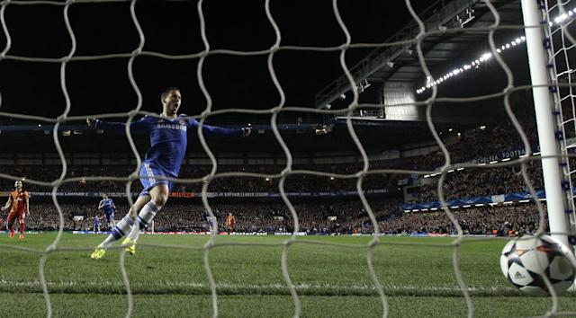 Chelsea's Eden Hazard celebrates after his Chelsea teammate Samuel Eto'o scores the opening goal of the game during the Champions League last 16 second leg soccer match between Chelsea and Galatasaray at Stamford Bridge stadium in London, Tuesday, March 18, 2014. (AP Photo/Matt Dunham)