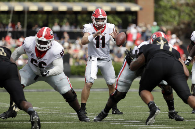 """Georgia quarterback <a class=""""link rapid-noclick-resp"""" href=""""/ncaaf/players/275086/"""" data-ylk=""""slk:Jake Fromm"""">Jake Fromm</a> (11) takes a snap against Vanderbilt in the first half of an NCAA college football game Saturday, Oct. 7, 2017, in Nashville, Tenn. (AP Photo/Mark Humphrey)"""