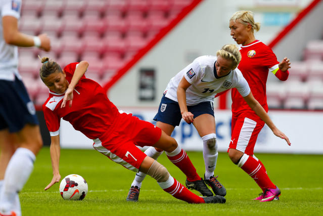 England's Toni Duggan in action against Belarus's Tatsiana Kiose during the FIFA Womens World Cup 2015 Group 6 Qualifier at the Goldsands Stadium, Bournemouth.
