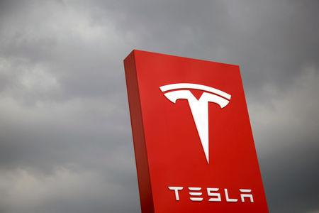 FILE PHOTO: The logo of Tesla is seen in Taipei, Taiwan August 11, 2017. REUTERS/Tyrone Siu/File Photo