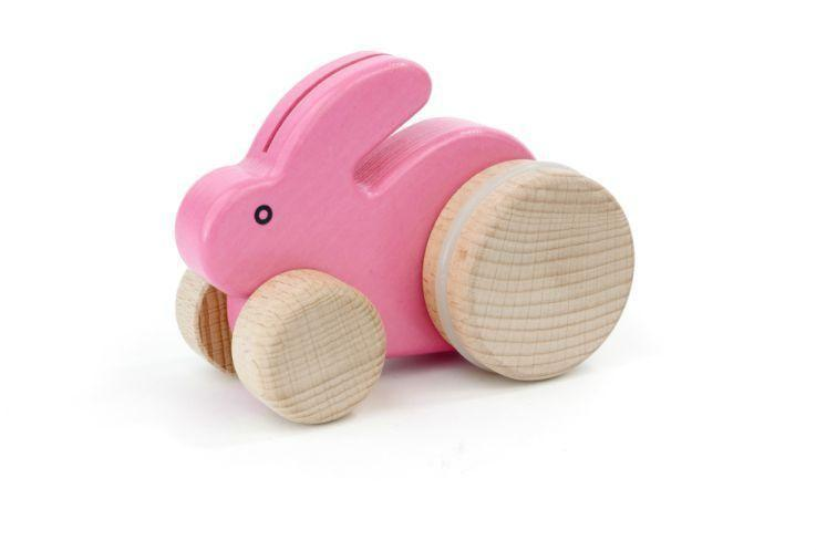 """<p>myshopify.com</p><p><strong>$22.00</strong></p><p><a href=""""https://little-poland-gallery.myshopify.com/products/wooden-bunny-small"""" rel=""""nofollow noopener"""" target=""""_blank"""" data-ylk=""""slk:Shop Now"""" class=""""link rapid-noclick-resp"""">Shop Now</a></p><p>This rolling wooden rabbit comes in a number of springy colors. </p>"""