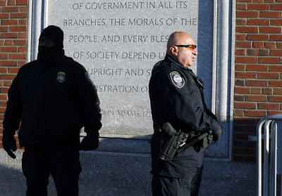 Police officers stand outside the federal courthouse in Boston, Monday, Jan. 5, 2015, for the first day of jury selection in the trial of Boston Marathon bombing suspect Dzhokhar Tsarnaev. (AP Photo/Michael Dwyer)