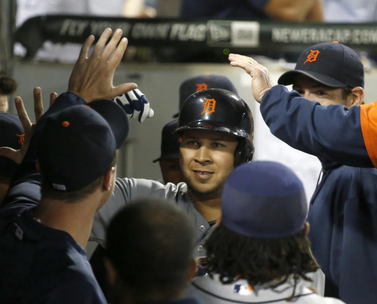Detroit Tigers' Jhonny Peralta celebrates in the dugout after hitting a home run off Chicago White Sox starting pitcher Hector Santiago during the sixth inning of a baseball game Tuesday, July 23, 2013, in Chicago. (AP Photo/Charles Rex Arbogast)