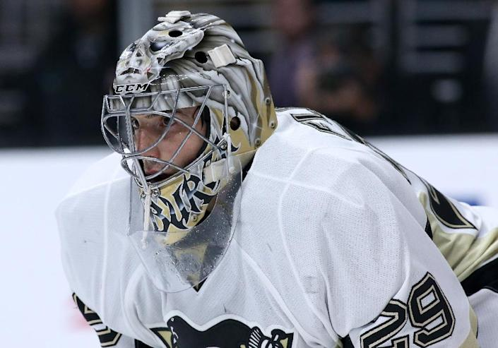 Goalie Marc-Andre Fleury of the Pittsburgh Penguins stopped 28 shots for his 10th shutout of the year as the Penguins reached the playoffs with a 2-0 win over the Buffalo Sabres (AFP Photo/Stephen Dunn)