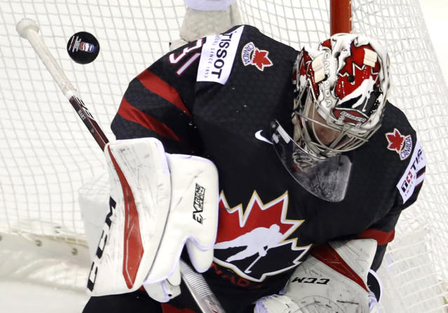 Canada's goaltender Carter Hart makes a save during the Ice Hockey World Championships group A match between Canada and Denmark at the Steel Arena in Kosice, Slovakia, Monday, May 20, 2019. (AP Photo/Petr David Josek)