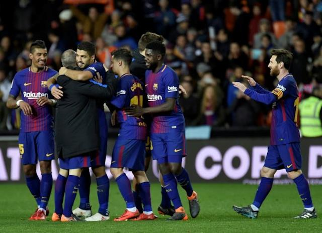 Barcelona players celebrate their qualification for the final match after the Spanish 'Copa del Rey' (King's cup) second leg semi-final football match between Valencia CF and FC Barcelona at the Mestalla stadium in Valencia (AFP Photo/JOSE JORDAN )