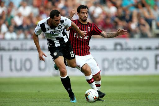 Udinese's Mato Jajalo, left, and Milan's Jesus Fernandez Suso vie for the ball during the Italian Serie A soccer match between Udinese and AC Milan at the Friuli stadium in Udine, Italy, Sunday, Aug. 25, 2019. (Gabriele Menis/ANSA via AP)