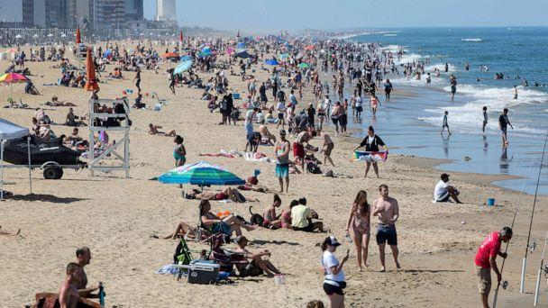 PHOTO: Warm weather draws crowds to the oceanfront, May 16, 2020, in Virginia Beach, Va. (Kaitlin McKeown/The Daily Press via AP)