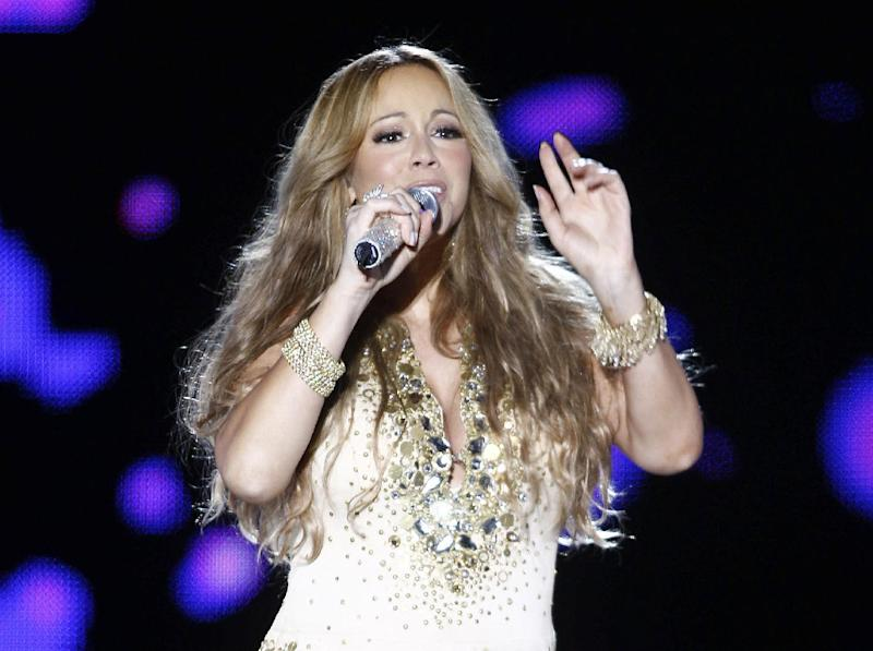 "FILE - This May 26, 2012 file photo shows U.S. Singer Mariah Carey performing on stage during a concert at the Mawazine Festival in Rabat, Morocco. Carey will be joining the cast of ""American Idol."" She told a meeting of the Television Critics Association that she is excited to join as a judge and it all happened quickly. (AP Photo/Abdeljalil Bounhar, file)"