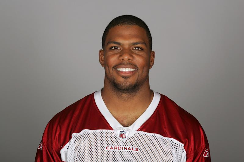 Jason Wright smiles at the camera in a head-and-shoulders pose in his Cardinals team portrait.