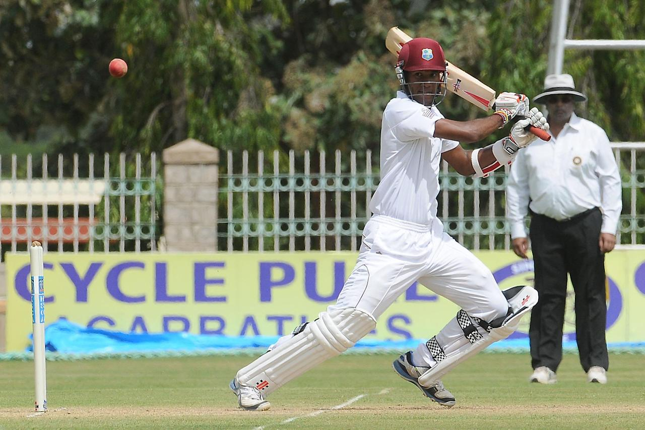 KA Edwards, West Indies A team Skipper and Kraigg Brathwaite in action during the 1st Test Match between India A and West Indies A at Gangothri Glades Cricket Ground, in Mysore on Sept. 25, 2013. (Photo: IANS)