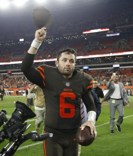 Cleveland Browns quarterback Baker Mayfield runs off the field after the Browns defeated the New York Jets 21-17 in an NFL football game Thursday, Sept. 20, 2018, in Cleveland. (AP Photo/Ron Schwane)