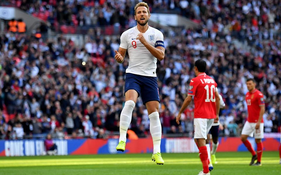 Harry Kane scores from the spot to double England's lead - AFP
