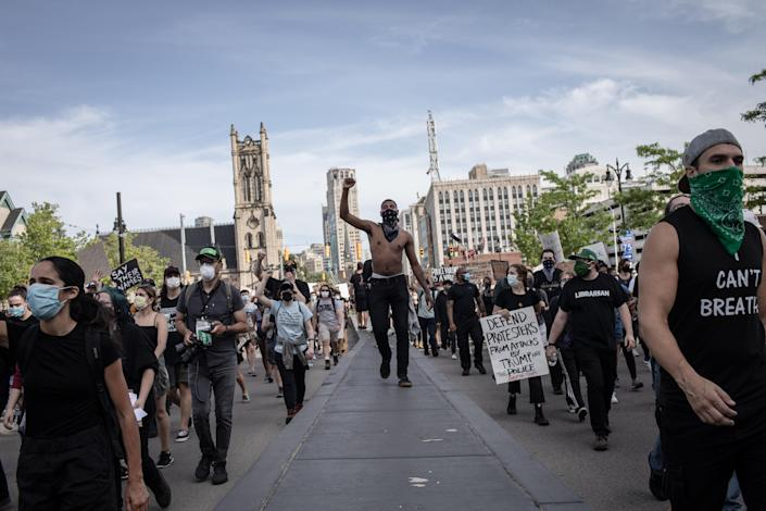 Protesters march against police brutality on Black Americans and the killing of George Floyd, in Detroit, June 3, 2020. (Erin Trieb/The New York Times)