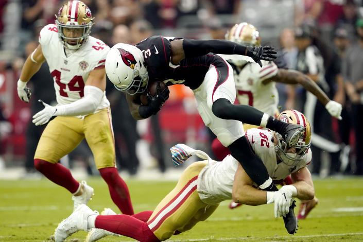 Arizona Cardinals safety Budda Baker (3) is tackled by San Francisco 49ers tight end Ross Dwelley (82) after an interception during the first half of an NFL football game, Sunday, Oct. 10, 2021, in Glendale, Ariz. (AP Photo/Darryl Webb)