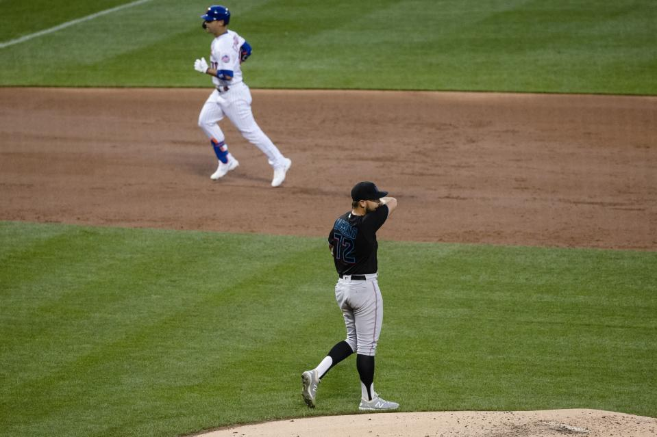 Miami Marlins relief pitcher Daniel Castano (72) reacts as New York Mets' Michael Conforto runs the bases after hitting a two-run home run during the second inning of a baseball game Saturday, Aug. 8, 2020, in New York. (AP Photo/Frank Franklin II)