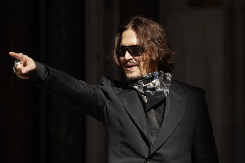 Actor Johnny Depp arrives at the High Court in London, in London, Monday, July 20, 2020. Amber Heard started Monday to give evidence at the High Court in London as part of Johnny Depp's libel case against The Sun over allegations of domestic violence during the couple's relationship. (AP Photo/Matt Dunham)