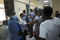 Medical staff wait in line to receive some of the country's first coronavirus vaccinations using AstraZeneca COVID-19 vaccine manufactured by the Serum Institute of India and provided through the global COVAX initiative, at Kenyatta National Hospital in Nairobi, Kenya Friday, March 5, 2021. Urgent calls for COVID-19 vaccine fairness rang through African countries on Friday as more welcomed or rolled out doses from the global COVAX initiative, with officials acutely aware their continent needs much more. (AP Photo/Ben Curtis)