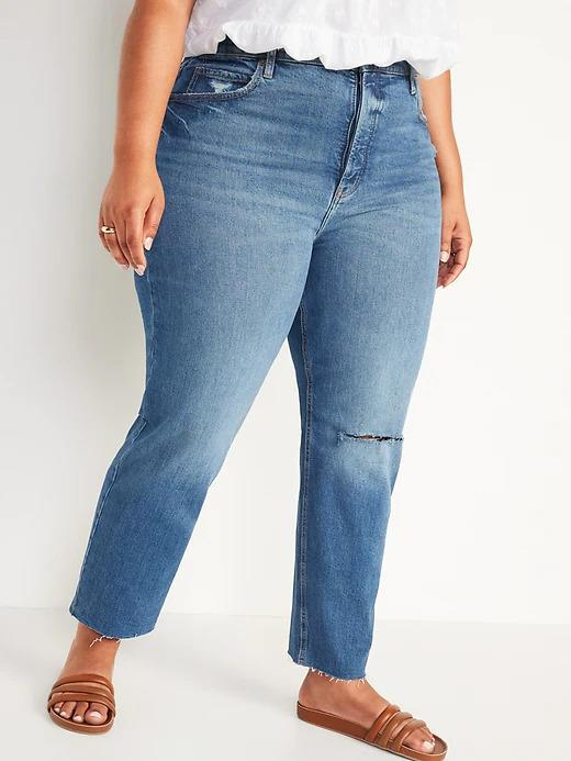Model wears Extra High-Waisted Sky Hi Straight Button-Fly Ripped Jeans in medium blue. Image via Old Navy.