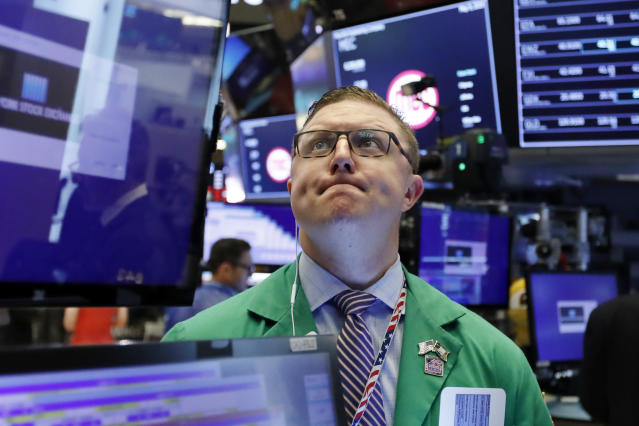 FILE - In this May 9, 2019, file photo trader Ryan Falvey works on the floor of the New York Stock Exchange. Banks and retailers pushed the market broadly lower in morning trading on Wall Street Wednesday, May 22. (AP Photo/Richard Drew, File)