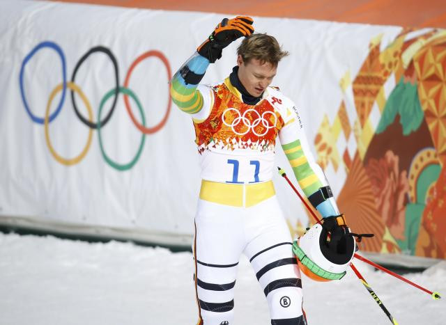 Germany's Stefan Luitz reacts after crashing into the last gate and being disqualified, during the first run of the men's alpine skiing giant slalom event in the Sochi 2014 Winter Olympics at the Rosa Khutor Alpine Center February 19, 2014. REUTERS/Kai Pfaffenbach (RUSSIA - Tags: OLYMPICS SPORT SKIING)