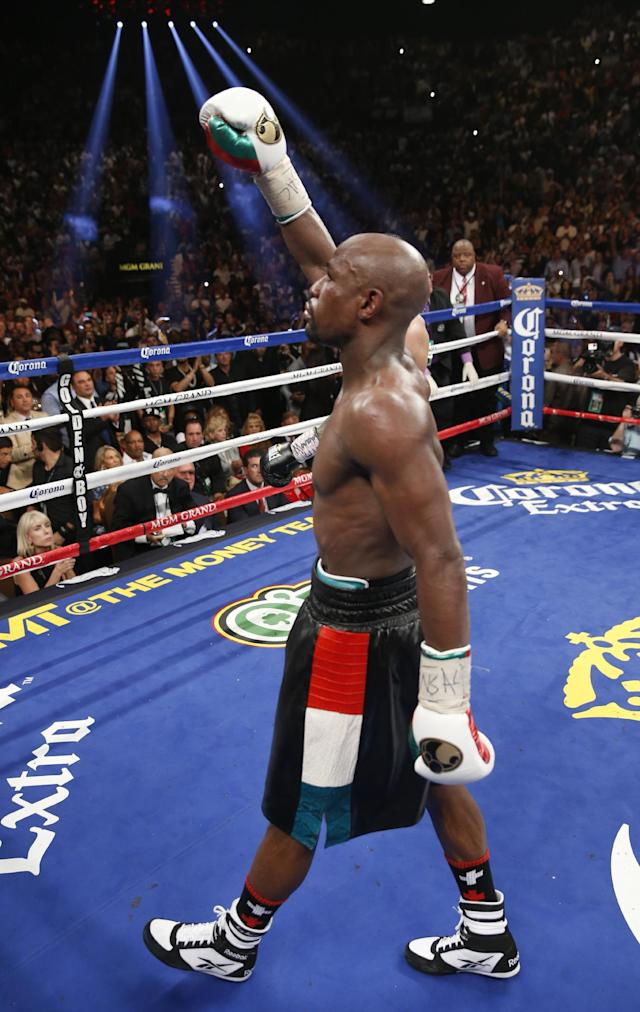 Floyd Mayweather Jr. celebrates his majority decision win over Marcos Maidana in their WBC-WBA welterweight title boxing fight Saturday, May 3, 2014, in Las Vegas. (AP Photo/Eric Jamison)