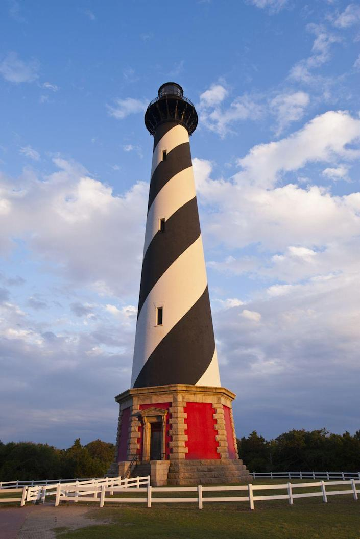 "<p><strong>Where: </strong>Cape Hatteras Lighthouse, North Carolina</p><p><strong>Why We Love It: </strong>While this Outer Banks landmark is the world's tallest brick lighthouse, its graphic black and white spiral is what landed it on this list of beautiful places.</p><p><strong>RELATED:</strong> <a href=""https://www.countryliving.com/life/travel/g2422/the-30-prettiest-lighthouses-in-america/"" rel=""nofollow noopener"" target=""_blank"" data-ylk=""slk:The Most Beautiful Lighthouses in America"" class=""link rapid-noclick-resp"">The Most Beautiful Lighthouses in America</a><br></p>"