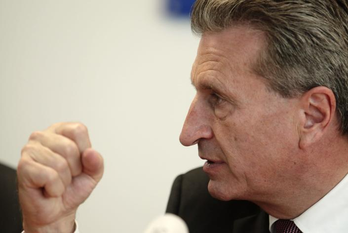 European Energy Commissioner Guenther Oettinger addresses a news conference in Vienna June 16, 2014. Oettinger said on Monday that Ukraine intended to fill its gas transit commitments to the European Union and he was also confident Russia would meet its gas supply pledges to the EU. REUTERS/Heinz-Peter Bader (AUSTRIA - Tags: POLITICS ENERGY)