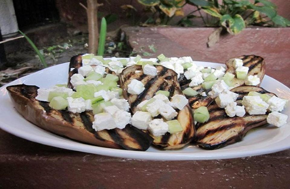"""<p>Eggplant develops a smoky flavor on the outside and a creamy texture on the inside when grilled. Paired with feta cheese crumbles and diced cucumber, this grilled vegetable is great for anyone on the <a href=""""https://www.thedailymeal.com/healthy-eating/mediterranean-diet-it-s-not-just-diet-it-s-lifestyle?referrer=yahoo&category=beauty_food&include_utm=1&utm_medium=referral&utm_source=yahoo&utm_campaign=feed"""" rel=""""nofollow noopener"""" target=""""_blank"""" data-ylk=""""slk:Mediterranean diet."""" class=""""link rapid-noclick-resp"""">Mediterranean diet.</a></p> <p><a href=""""https://www.thedailymeal.com/recipes/grilled-eggplant-feta-and-cucumber-recipe?referrer=yahoo&category=beauty_food&include_utm=1&utm_medium=referral&utm_source=yahoo&utm_campaign=feed"""" rel=""""nofollow noopener"""" target=""""_blank"""" data-ylk=""""slk:For the Grilled Eggplant With Feta and Cucumber recipe, click here."""" class=""""link rapid-noclick-resp"""">For the Grilled Eggplant With Feta and Cucumber recipe, click here.</a></p>"""