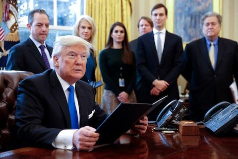 Hope Hicks among Donald Trump's key staff, including Kellyanne Conway and Jared Kushner, at the Oval Office in January - Credit: Shawn Thew-Pool/Getty Images