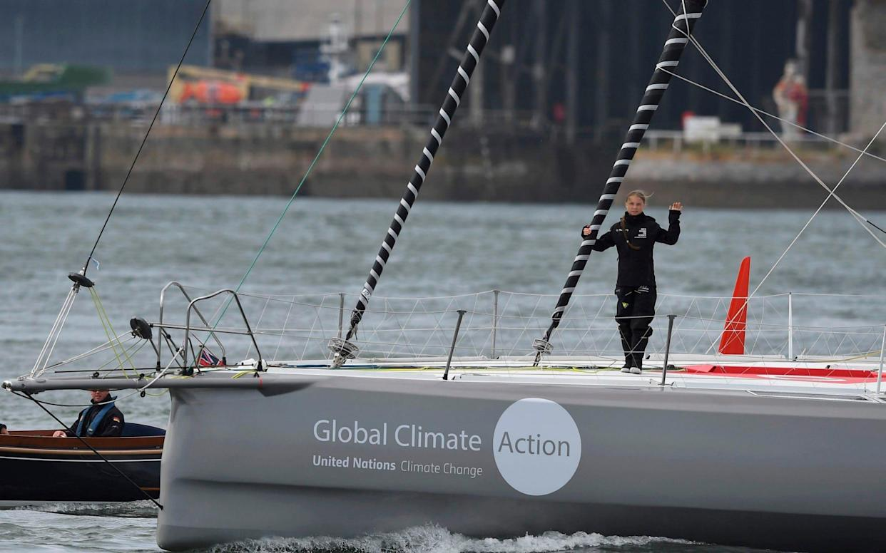 Ms Thunberg waved from the yacht as she set off from Plymouth on Wednesday afternoon - AFP