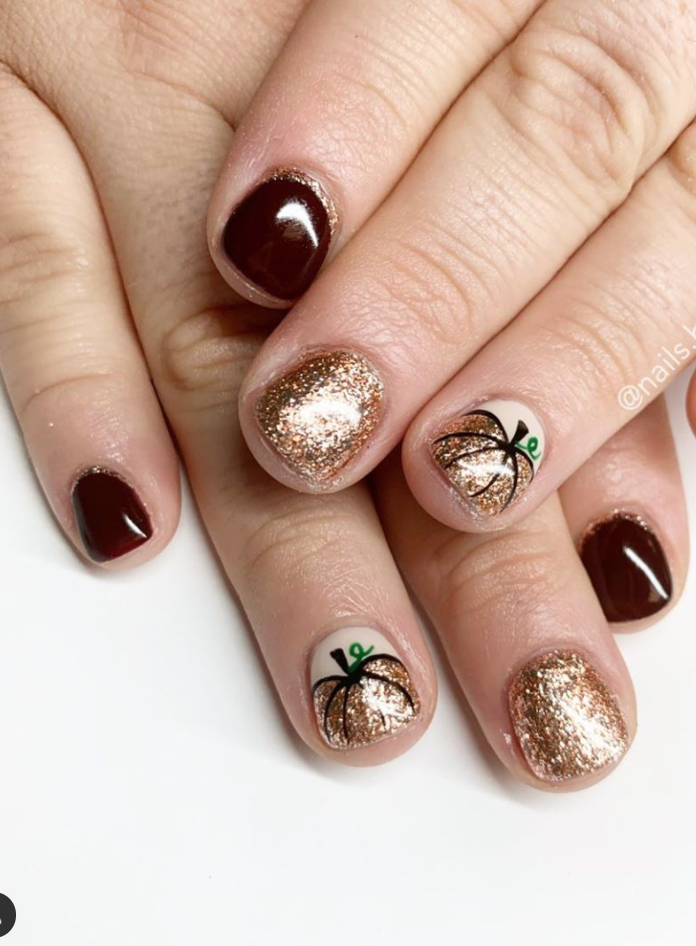 """<p>Perfect for those who want a Halloween manicure that's also fit for the fall season, these golden pumpkins (paired with a dark red) <a href=""""https://www.instagram.com/p/B4PxHPjBmzr/"""" rel=""""nofollow noopener"""" target=""""_blank"""" data-ylk=""""slk:by nail tech Liz Henson"""" class=""""link rapid-noclick-resp"""">by nail tech Liz Henson</a> is giving us all the autumnal vibes. </p><p><a class=""""link rapid-noclick-resp"""" href=""""https://go.redirectingat.com?id=74968X1596630&url=https%3A%2F%2Fwww.ulta.com%2Fglazen-peel-off-glitter-lacquer%3FproductId%3DxlsImpprod18911033&sref=https%3A%2F%2Fwww.oprahmag.com%2Fbeauty%2Fskin-makeup%2Fg33239588%2Fhalloween-nail-ideas%2F"""" rel=""""nofollow noopener"""" target=""""_blank"""" data-ylk=""""slk:SHOP GLITTER POLISH"""">SHOP GLITTER POLISH</a></p>"""