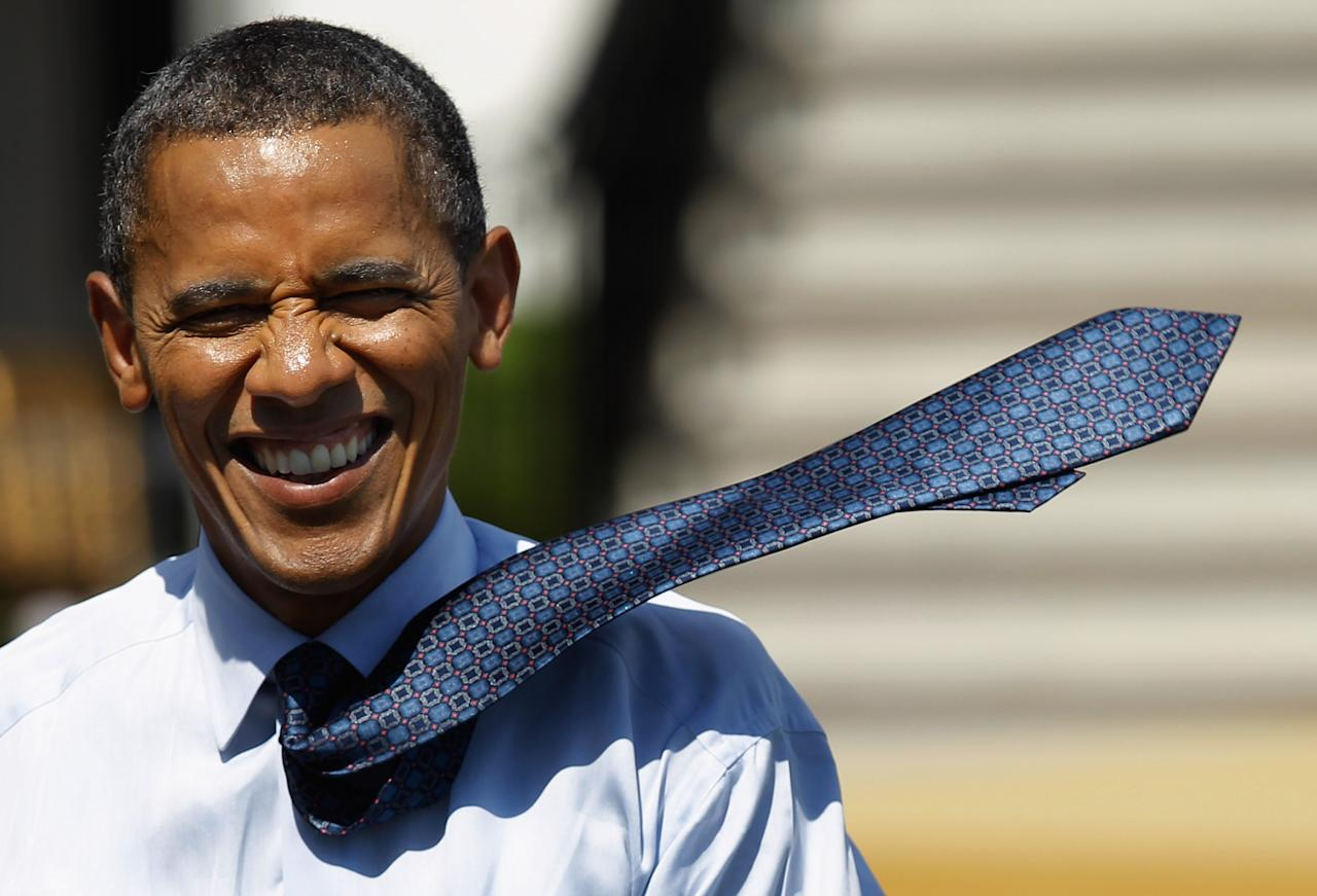 WASHINGTON, DC - JUNE 08:  The wind picks up U.S. President Barack Obama's tie as he walks back to the Oval Office after welcoming the National Football League Super Bowl champions New York Giants to the White House June 8, 2012 in Washington, DC. The Giants defeated The New England Patriots 21-17 to win Super Bowl XXXXVI.  (Photo by Chip Somodevilla/Getty Images)