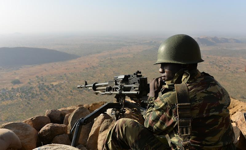 A Cameroonese soldier holds a position near the northern village of Mabass (AFP Photo/Reinnier KAZE)