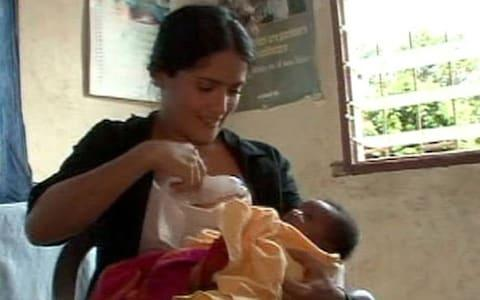 Actress Salma Hayek breastfed a sick baby on a 2009 charity trip to Sierra Leone - Credit: ABC News