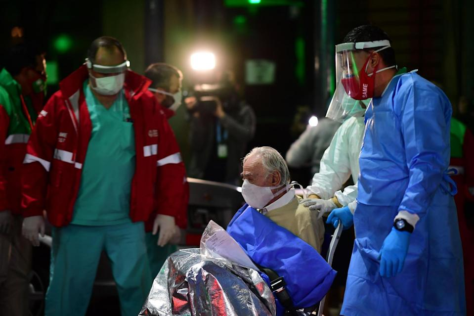 An elderly man with symptoms of Covid-19 is transferred from the Carpe Diem nursing home to a hospital in Buenos Aires: AFP via Getty Images